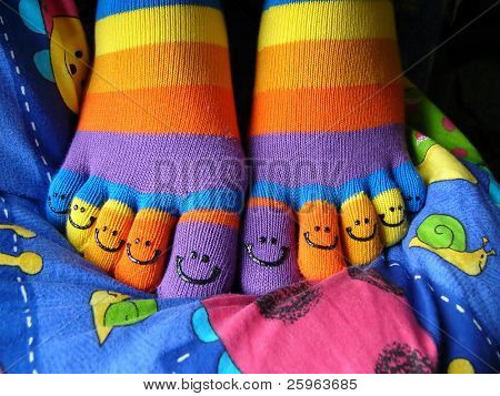 Smiley socks on smiley coverlet