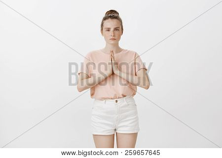 Girl Studying Martial Arts, Bowing To Sensei. Serious, Determined Good-looking Woman With Freckles I