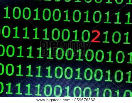 Programming Code On A Black Background. A Binary Code With An Error. Digit 2 In Binary Code