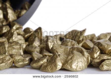 Gold Nuggets Tumbling Out Of A Bucket