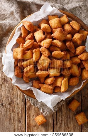 West African Popular Food: Appetizer Chin Chin Fried Crispy Dough Close-up In A Bowl. Vertical Top V