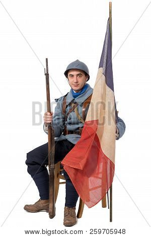 A French Soldier, 1914 1918  Sitting With Flag, Isolated On White Background