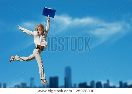 Successful business woman holding document folder