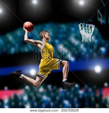 Basketball Player Making Slam Dunk On Basketball Arena