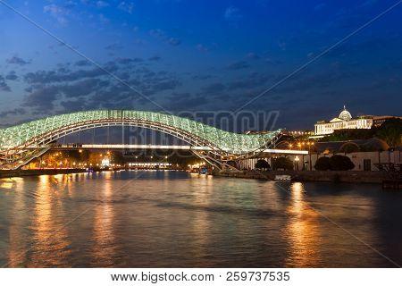 Tbilisi, Georgia - September 02, 2018 Skyline Night View Of Tbilisi City, Modern Illuminated Bridge