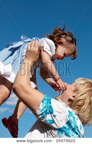 grandmother with granddaughter outdoors