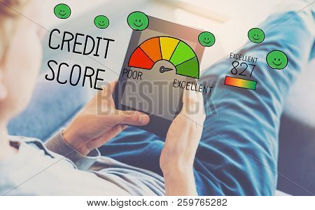 Excellent Credit Score With Man Using A Tablet In A Chair