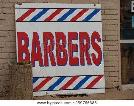 A Modern Day Barber Sign Gets The Job Done At This Shop.