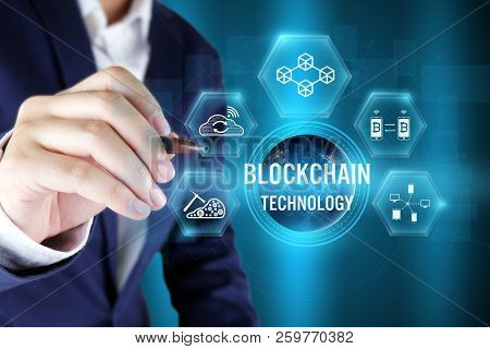 Businessman Pointing Blockchain Icon On Virtual Screen,blockchain Technology Concept,elements Of Thi