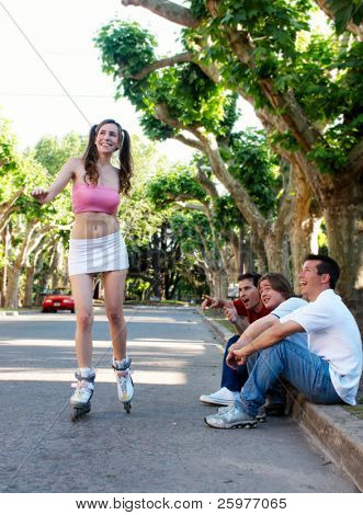 The girl on rollers under exulting barrackings of guys