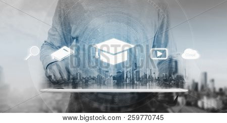 Online Education, E-learning And E-book Concept. A Man Using Digital Tablet For Education, With Educ