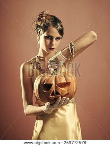 Halloween Girl In Yellow Dress With Pumpkin. Beauty And Vintage Fashion. Halloween Holiday And Party