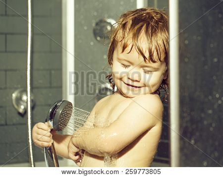 Cute Happy Smiling Funny Undressed Boy Child With Blonde Curly Wet Hair Taking Shower In Bath With W