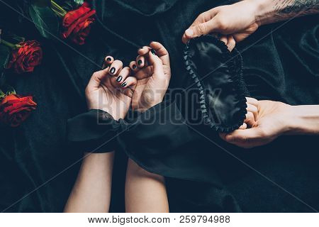 Cropped Shot Of Woman With Tied Hands And Man Holding Black Mask
