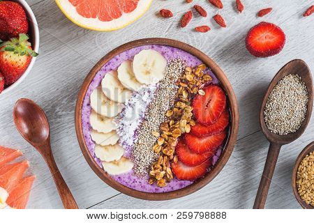 Acai Smoothie Bowl With Superfoods. Smoothy Bowl Topped With Banana, Chia Seed, Coconut, Strawberry