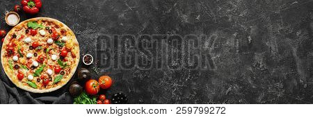 Italian Pizza And Pizza Cooking Ingredients On Black Concrete Background. Tomatoes On Vine, Mozzarel
