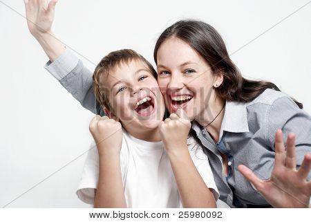 Portrait happy family football fans on light background