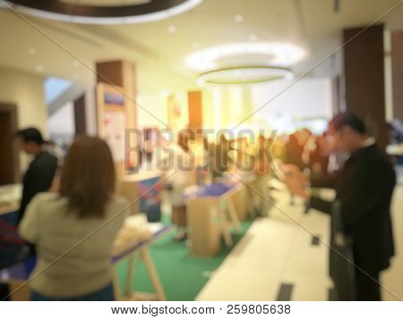 Blurred Image Of People Walking On A Trade Fair Exhibition Or Expo Where Business People Show Innova