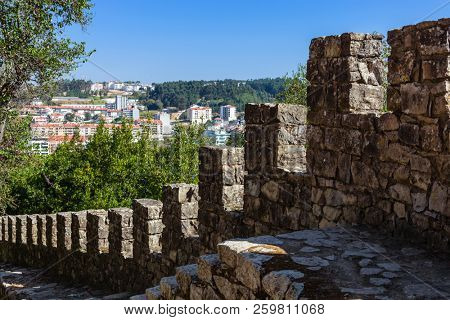 Leiria, Portugal - October 10, 2017: Close-up on a castle defensive wall with the battlements, merlons, crenels or crenellation of the wall and wallwalk in Leiria Castle