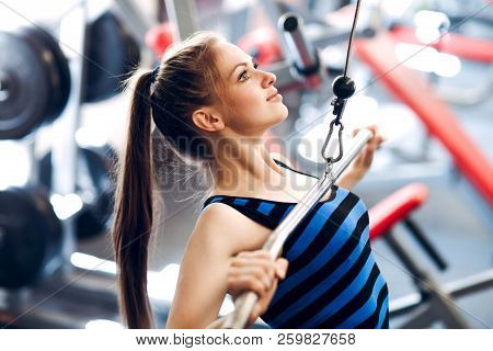 Young Woman Exercising. Fitness Physical Exercise In Gym.