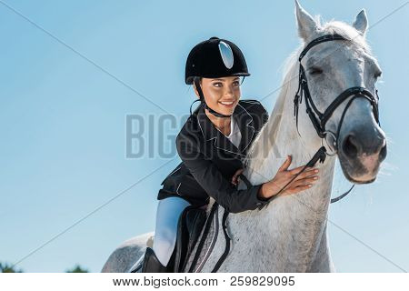 Attractive Female Equestrian Riding Beautiful White Horse At Horse Club