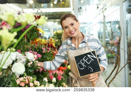 Female Florist Holding Sign
