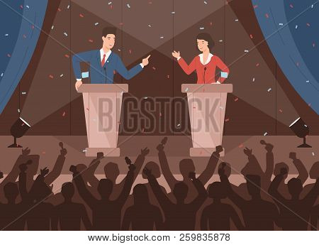 Male And Female Politicians Taking Part In Political Debates In Front Of Audience. Pair Of Governmen