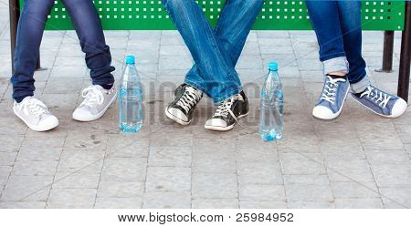 teens in jeans and sneakers in street