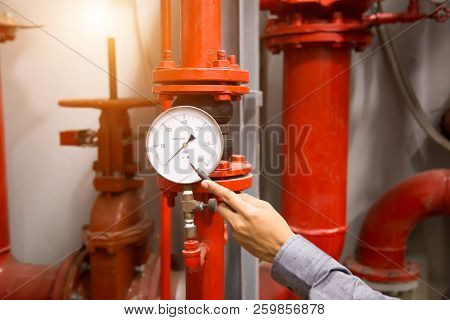 Engineer Checking Condenser Water Pump And Pressure Gauge , Chiller Water Pump With Pressure Gauge.