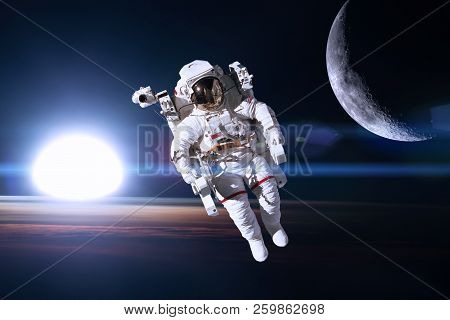 Astronaut In Outer Space On Background Of The Night Earth. Elements Of This Image Furnished By Nasa.