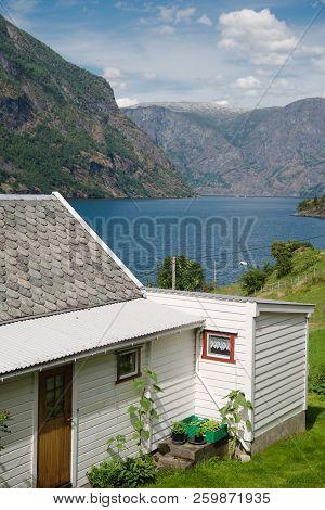 Cozy Wooden White House And Majestic Landscape In Gudvangen, Naeroyfjord, Norway