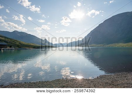 Beautiful Landscape With Majestic Mountains Reflected In Calm Water Of Gjende Lake, Besseggen Ridge,