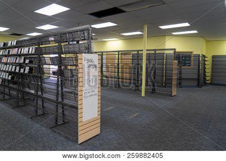 August 12 2018 - Fairbanks Alaska: Empty Video Rental Shelves Inside Of A Closing Blockbuster Video