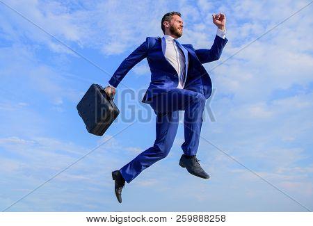 Success in business demands supernatural efforts. Businessman with briefcase jump high in motion forward. Supernatural power. Businessman formal suit make effort to succeed blue sky background poster