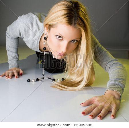 fashion woman crawling with a hispanic looking