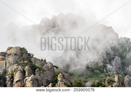Demerdji Mountain In Evening Fog, Crimea, Russia. Beautiful View Of A Misty Mountain Range. Scenery