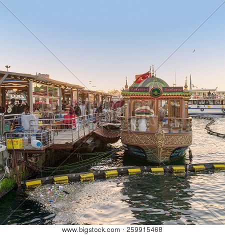 Istanbul, Turkey - April 25, 2017: Traditional Fast Food Bobbing Boat Serving Fish Sandwiches At Emi
