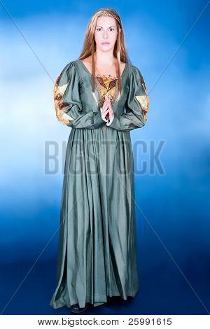 Great fancy-dress woman in Renaissance style, studio shot