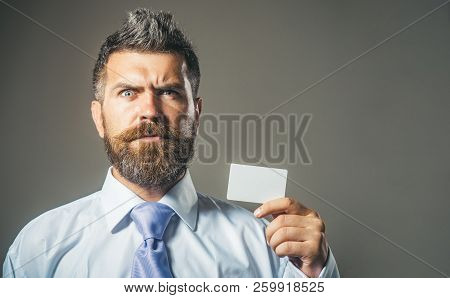 Business Man Holds Blank White Credit Card. Banking, Finance, Online Payment, E-money. Credit/debit
