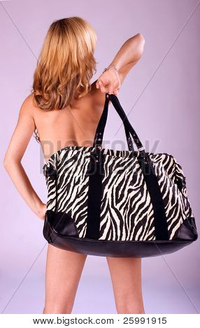 Beautiful fashion woman with big bag portrait, studio shot