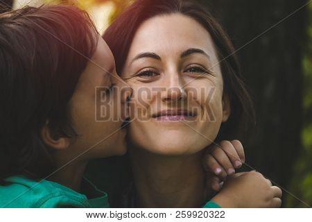 The Kid Kisses The Parent.