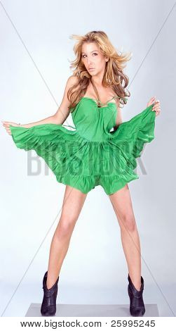 Beautiful fashion woman portrait in green dress