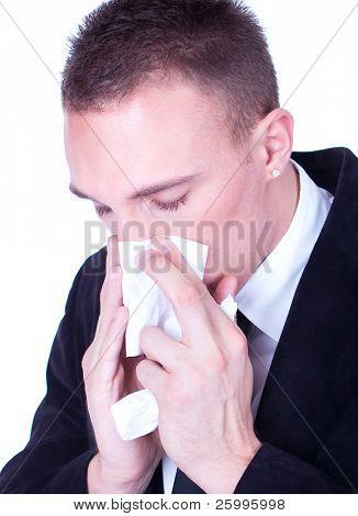 Sneeze... Businessman with a big influenza hold handkerchief