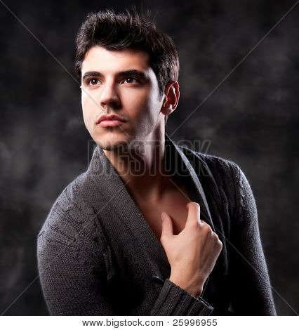 Fashion Shot of a Young Man A trendy European man dressed in contemporary cloth. He is now a professional model.