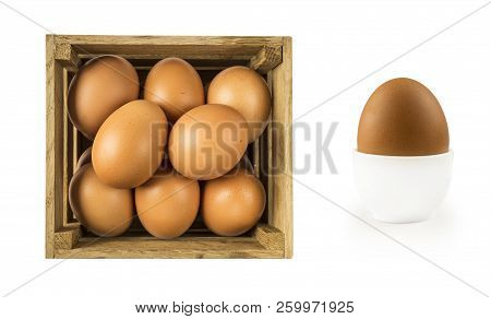 Boiled Egg Isolated On White Background. Boiled Egg In Eggcup And Eggs Isolated In Wooden Bowl . Clo