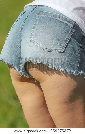 Legs Of A Girl In Short Shorts .