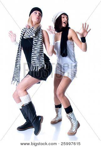 Two young pretty Women posing , studio shot