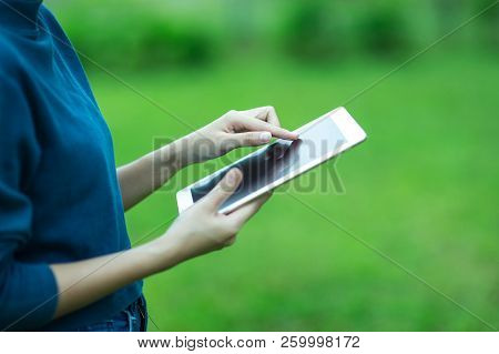 Woman's Hand Holding Tablet