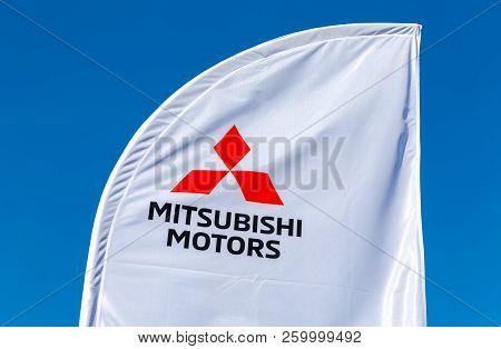 Samara, Russia - September 23, 2018: Official Dealership Sign Mitsubishi Against A Blue Sky
