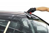 A man cleaning car with microfiber cloth, car detailing (or valeting) concept. Selective focus. Car detailing. Cleaning with sponge. Worker cleaning. Microfiber and cleaning solution to clean poster